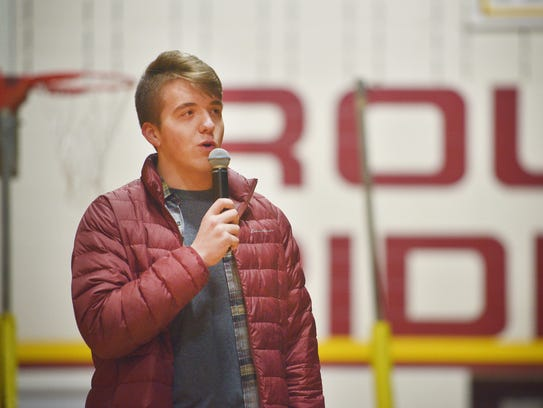 Roosevelt High School student Alex Cook makes a brief