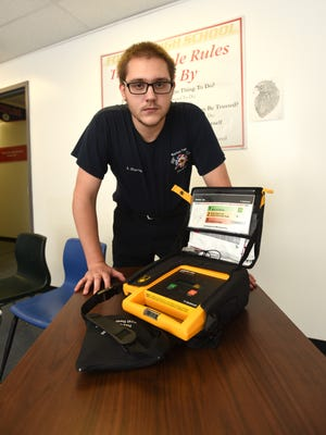 Austin Sharrer became the first student to complete the EMT program at Foxfire High School recently. Hewill become a Basic EMT after finishing his coursework at Mid-East Career Center in November.
