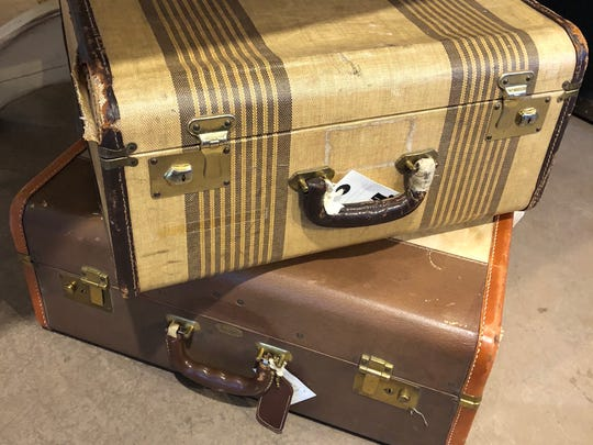 Stacking these suitcases is great to create a side table and is a nice way to incorporate vintage pieces.