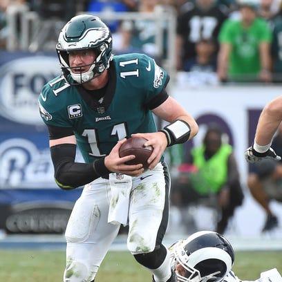 Philadelphia Eagles quarterback Carson Wentz (11) breaks