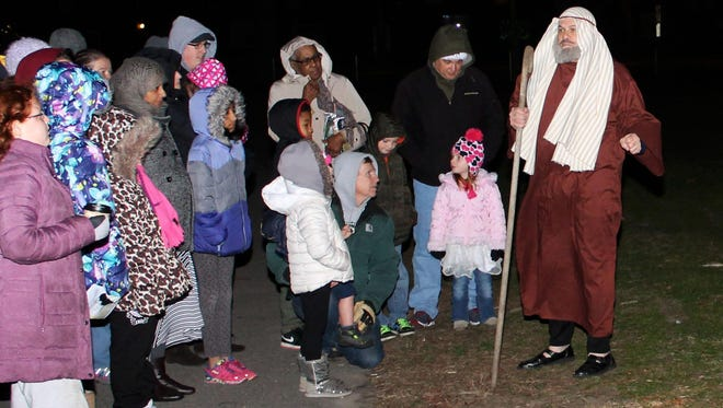 Joe Orazi, as Justus the Shepherd, relates the Christmas story to attendees at Cumberland County Community Church's first living Nativity.