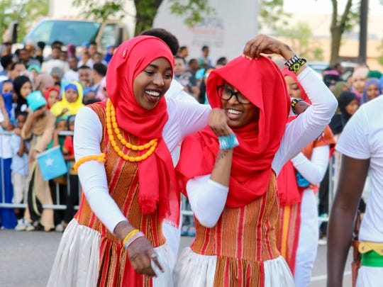 """The young men and women of the Somali Museum Dance Troupe study and perform traditional dances from all regions of Somalia. The dancers are high school and college students passionate about sharing their culture. They perform throughout the United States. The """"Somalis + Minnesota"""" exhibit opens June 23, 2018 at the Minnesota History Center."""