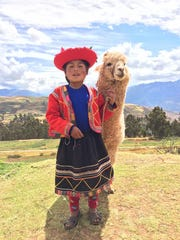"Maureen (Mo) Churan-King: ""A young Peruvian girl with her llama. The inspiration for this photo was to get an image that captured the colorful, rustic beauty of the Peruvian people and their bucolic countryside."" Maureen (Mo) Churan-King worked as an engineer for Eastman Kodak for 32 years. She loves traveling to exotic places to capture images of unique cultures and people."