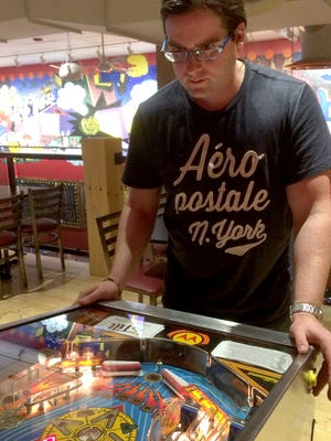 Jeffrey Coy of South Starksboro plays a game of Whirlwind at Tilt, a pinball arcade and bar in South Burlington.