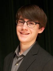 David Harmsworth, 17, joins the Great Falls Symphony onstage Saturday.
