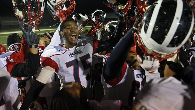 Eastmoor Academy players celebrate after defeating Bishop Hartley in a football playoff game in 2018. The OHSAA gets 80% of its revenue from ticket sales for tournament games in football and other sports.
