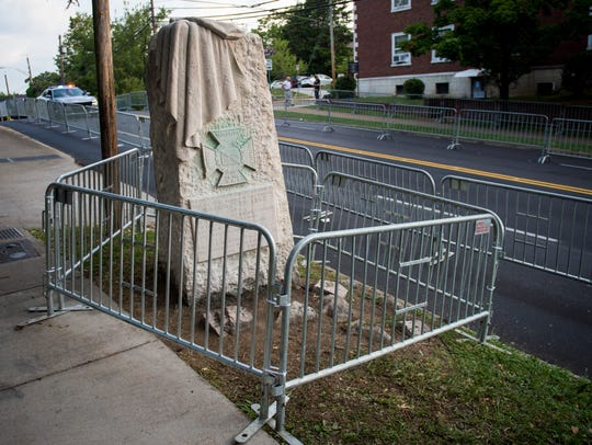 Barricades surround the confederate monument being