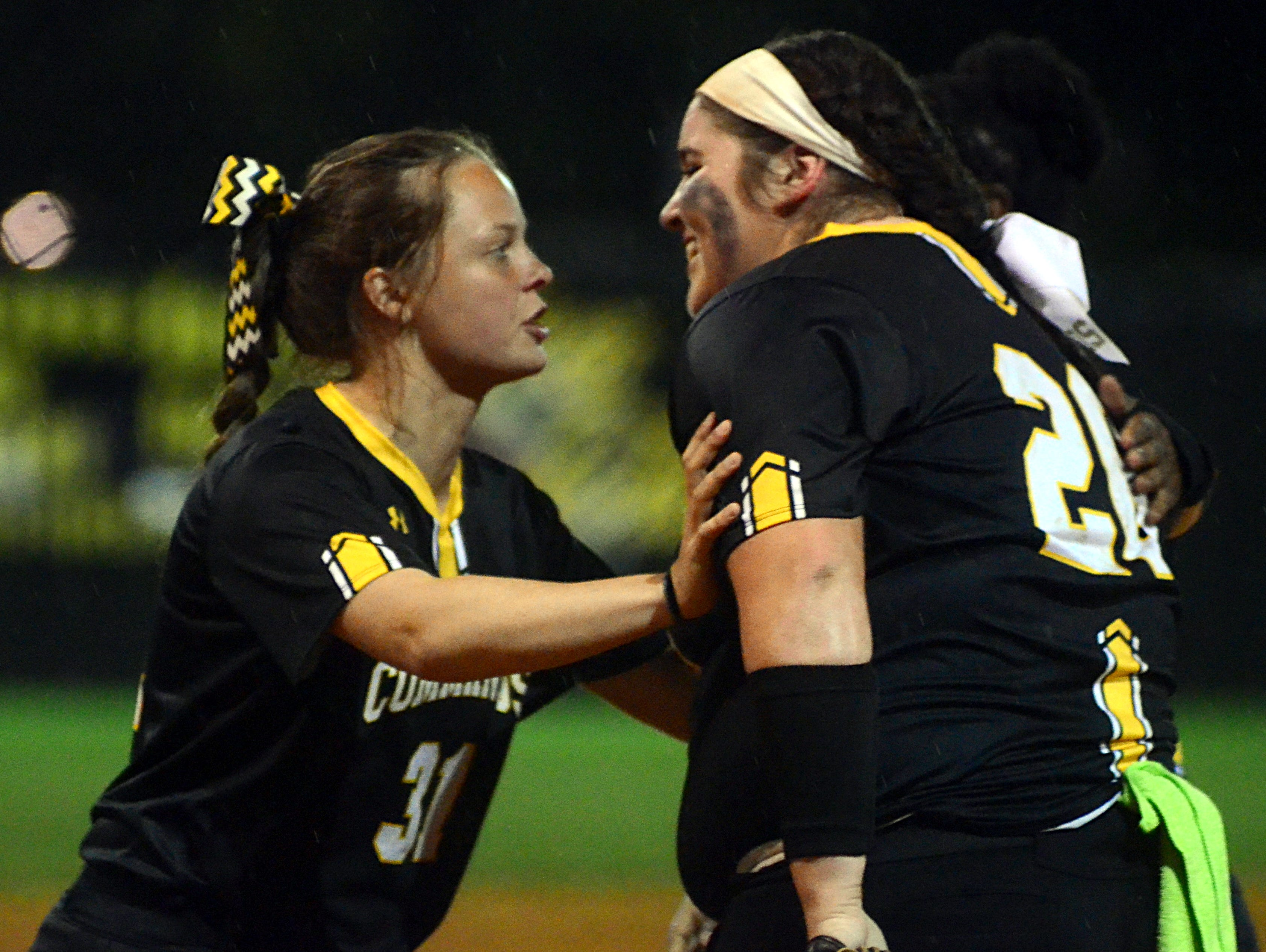 Hendersonville High senior Hannah Atkinson (left) congratulates classmate Carley Carlisle following the Lady Commandos' 5-2 victory over Henry County on Monday evening.