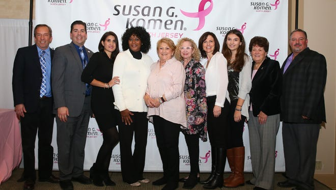"Susan G. Komen North Jersey held their 2017 Volunteer Recognition Tea on November 19th at Shackamaxon Country Club in Scotch Plains. The event, which is given as a ""thank you"" for all those who volunteered for the organization during the previous year, also honored ten outstanding individuals for their exceptional contributions and extraordinary dedication to the mission of the Affiliate. From left to right, Charles Wolf of Branchburg received the Real Men Wear Pink Award, Walter Cmielewski of Flanders and Eloquent Studios of Chester received the Extra Mile Award, Marcy Prendes of Bridgewater received the Promise of One Award; Sharon Daughtry-Simon of Secaucus received the Susan G. Komen North Jersey Volunteer of the Year Award, Lois Solomon of East Brunswick received the Extra Mile Award, Peggy Forma of East Brunswick received the Extra Mile Award, Judy Swajger of West Milford received the New Volunteer Award, Jiana Ingrassia of Westfield received the Student Volunteer Award, Lona Scala of North Plainfield received the Promise of One Award and Dave Schneider/Fras-Air Service Experts of Hillsborough received the Partners in the Promise Award. Caption Override"