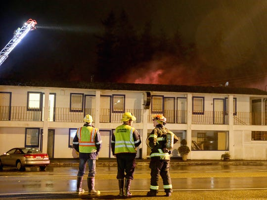 Firefighters gather at the Feb. 9 blaze at the Blue Water Inn in Kingston.