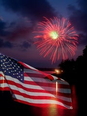 American flag with fireworks in background
