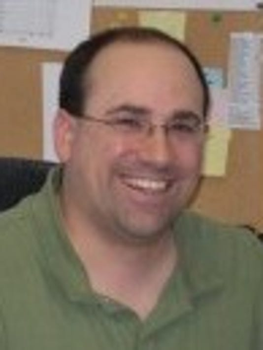 Nate Adams headshot.jpg