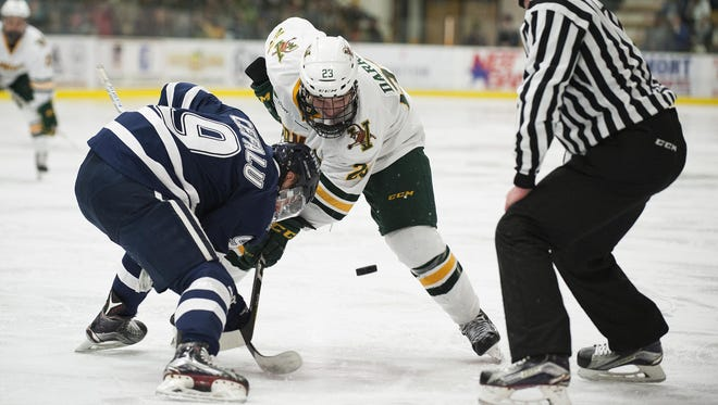 Catatmounts forward Rob Darrar (23) and Wildcats forward Frankie Cefalu (9) battle for the face off during the men's hockey game between the New Hampshire Wildcats and the Vermont Catamounts at Gutterson Field House on Friday night February 10, 2017 in Burlington. (BRIAN JENKINS/for the FREE PRESS)