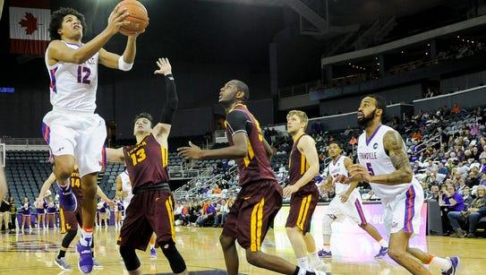 Evansville Aces guard Dru Smith (12) shoots past Loyola