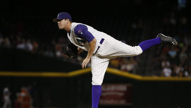 Arizona Diamondbacks pitcher Andrew Chafin throws to the San Francisco Giants in the 8th inning in Phoenix, Ariz., on Thursday, May 12, 2016.