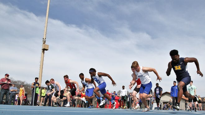 Oak Creek junior Cornelius Bright (third from right) and senior teammate Roy Harden (fourth from right) take off in the first heat of the 100-meter dash. a