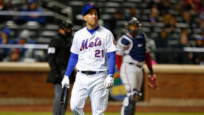Mets third baseman Todd Frazier (21) walks to the dugout after being called out on strikes in the fourth inning against the Washington Nationals at Citi Field.
