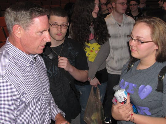 Suicide prevention activist Kevin Briggs of California speaks with Elmira High School senior Aliyya Stermer after his program there Friday afternoon.
