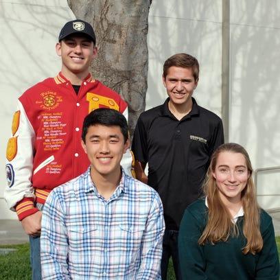 From left, seniors Liam McMillin, Joshua Rhee, Matthew