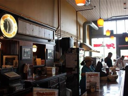This Oct. 10, 2014 photo provided by the Springfield, Missouri, Convention & Visitors Bureau shows the interior of Pizza House on Commercial Street.