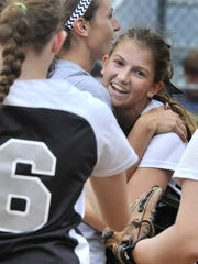 Sussex Tech pitcher Taylor Wroton is congratulated by her teammates after she escaped a third inning scare unscathed when the Spartans had the bases loaded and no outs.