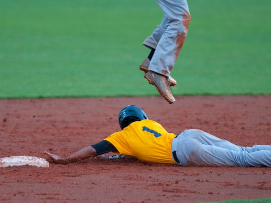 Gulf Coast's Jonathan Cosme steals second base during the game.