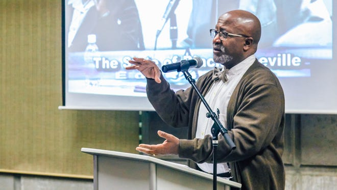 UNC Asheville political science professor Dwight Mullen speaks during the 2016 State of Black Asheville event.