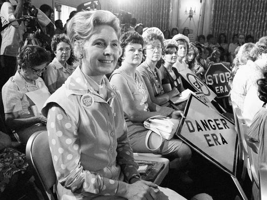 In this Aug. 10, 1976 file photo, women opposed to the Equal Rights Amendment sit with Phyllis Schlafly, left, national chairman of Stop ERA, at hearing of Republican platform subcommittee on human rights and responsibilities in a free society in Kansas City, Mo. One of the leading opponents of the ERA during the 1970s was conservative Illinois lawyer Phyllis Schlafly, who launched a campaign called Stop ERA and is credited with helping mobilize public opinion against the amendment in some of the states that balked at ratifying it.