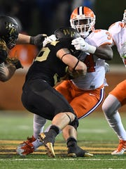 Clemson linebacker Kendall Joseph (34) brings down Wake Forest tailback Cade Carney (36) during the 3rd quarter at Wake Forest's BB&T field on Saturday, November 19, 2016.