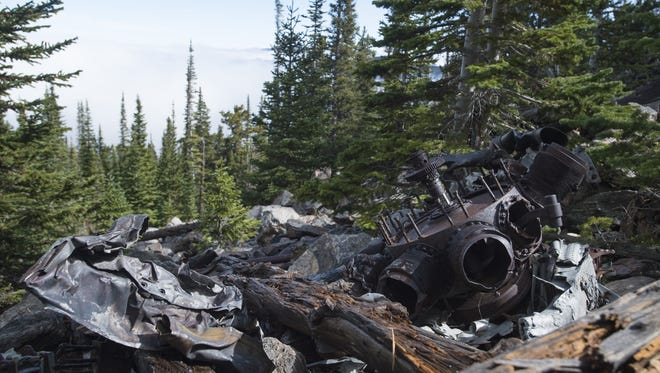 Remnants of an engine for a B-17 bomber aircraft sit along fallen trees above the clouds in Pingree Park on Friday, September 29, 2017. Hikers can find a network of trails leading to the site of the 1943 plane crash.