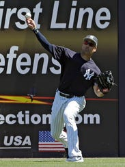 New York Yankees right fielder Giancarlo Stanton fields