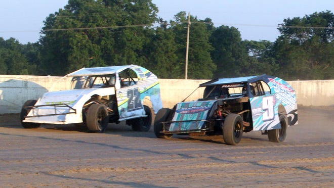 Cole Campbell of Mexico (#22C car) and Chad Hickam of Centralia (#9 car) emerge out of turn 2 at Randolph County Raceway while competing in a B-Modifieds rrace held earlier this season. On Sunday, July 26 Hickam placed 13th and Campbell 16th among 21 drivers.