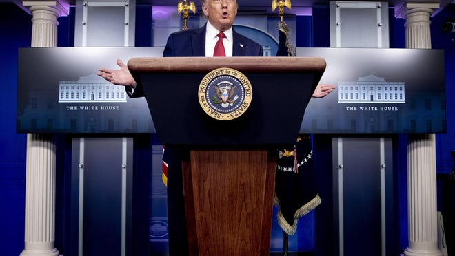 """President Donald Trump speaks during a news conference in the James Brady Press Briefing Room at the White House, Monday, Aug. 10, 2020, in Washington. Trump has a ready solution for almost any crisis: more of Donald Trump. In a template forged in his 2016 convention speech when he declared that """"I alone can fix it,†the president has repeatedly put himself forth as the answer."""