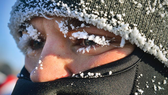Cooperstown, No. Dak., resident Jeff Kenninger's eyelashes were flocked better than most Christmas trees after running the CentraCare Wishbone 5K Walk/Run on Thanksgiving Day at Whitney Park. The temperatures at the race start were in the single digits below zero.