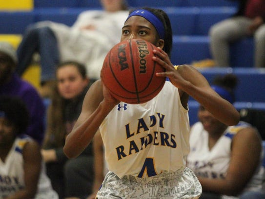 Rickards' Keshonda Gaskins prepares to launch a 3-pointer.