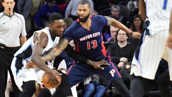 Pistons forward Marcus Morris (13) tries to strip the ball from Magic forward Jeff Green (34) in the fourth quarter.