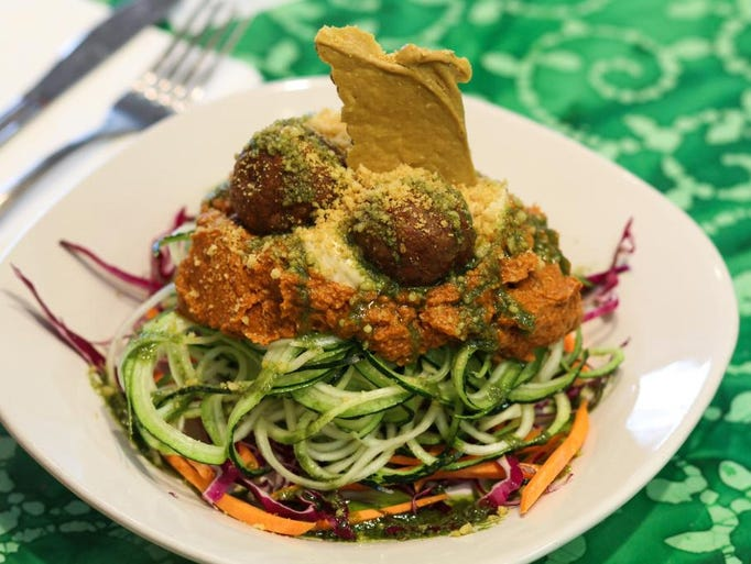 Live Spaghetti -- angel hair zucchini noodles topped with sun-dried sun-dried tomato sauce, with nut and veggie meatballs -- at Good Karma in Red Bank.
