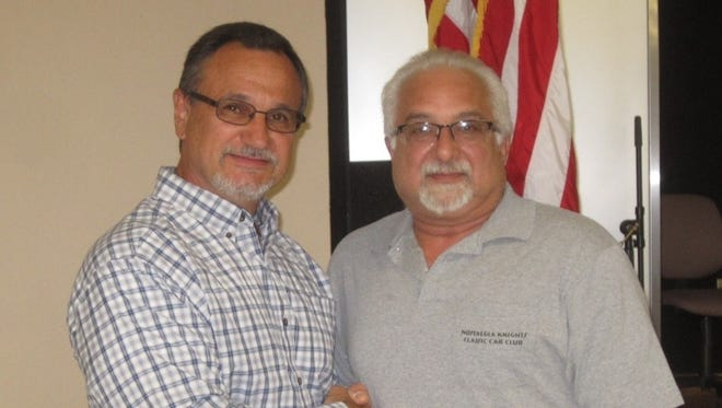 Boris Reissek (left) of the New Jersey Veterans Memorial Home in Vineland accepts a donation of $4,000 from Bill Nese, president, Nostalgia Knights Classic Car Club. The donation was made possible through the Salute to Our Veterans Car Cruise, which was hosted by the Knights, the South Jersey Cruisers Association, Cruisin' 92.1 and DJ Steve Tatz, and the Fox Family.