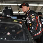 Martin Truex Jr. climbs into his car to practice for the Sprint Showdown on May 15 in Concord, N.C. Truex has 12 top-10 finishes in 13 races so far this year.
