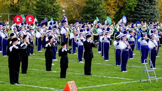 Marching bands from Green Bay East, West, Southwest, and Preble perform the National Antherm during the second annual Marching Band Showcase at Green Bay East High School's City Stadium.