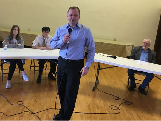 Beau Liegeois speaks during a town hall Saturday at