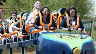 Associated Press reporter Rebecca Santana, front left, rides Six Flags Great Adventure's new roller coaster, Kingda Ka, in Jackson, N.J., Thursday, May 19, 2005. Six Flags Great Adventure offered some riders a preview of its new Kingda Ka coaster, which is to open to the general public Friday. Accompanied in a coaster car by winners of an auction and other reporters, I was catapulted down a track from a standstill to 128 mph in 3.5 seconds, then shot up at a 90-degree angle to more than 45 stories in the air.  Six Flags officials say that, on a clear day, brave riders who open their eyes at the summit can see the buildings of downtown Manhattan, 84 miles to the northeast.(AP Photo/Tim Larsen) ORG XMIT: NJTL105