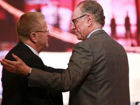 IOC Vice President John Coates, left, and Carlos Nuzman, president of the Rio 2016 Organizing Committee, right, greet each other during the closing plenary session of the IOC Debriefing of the Olympic Games Rio 2016, in Tokyo, Wednesday, Nov. 30, 2016.The three-day IOC debriefing ends Wednesday to share knowledge and experiences between the Rio Olympic Games organizers and future host cities, including Tokyo which will host the 2020 Olympics and Paralympics. (AP Photo/Eugene Hoshiko)