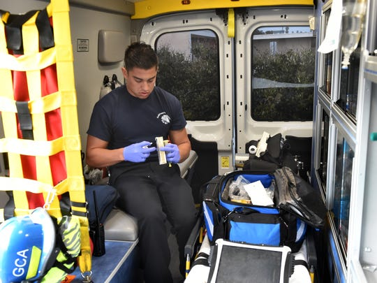 Arthur Cardenas, a paramedic with Gold Coast Ambulance, restocks a drug called Narcan as he starts his shift in Oxnard. The drug is used to treat overdoses of heroin and other opioids.