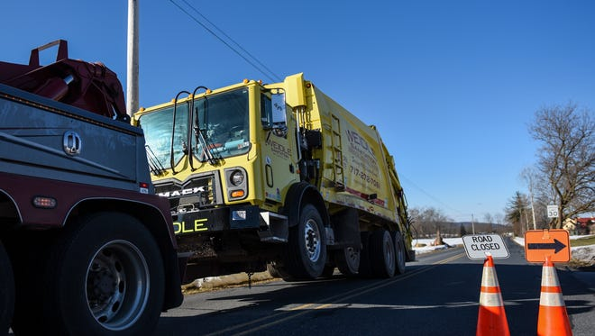 A tow truck hauls away a Weidle Sanitation truck that was involved in a fatal crash Thursday, Feb. 18, 2016, in the 1100 block of Eby Road in South Londonderry Township. Weidle employee Dale Glant, 51, of Lebanon, was struck and killed.