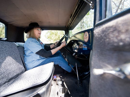 Sherry Hinnant talks about features inside her 1931 Ford Model A Coupe while sitting Wednesday behind the wheel. Hinnant will be traveling 300 miles for her high school reunion in the Model A, the same car she drove when she was a student.