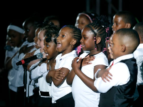 Kids from Wilson Foundation Academy recite words to