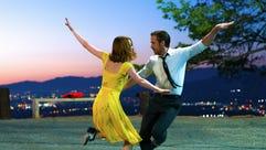 Emma Stone and Ryan Gosling in a scene from 'La La