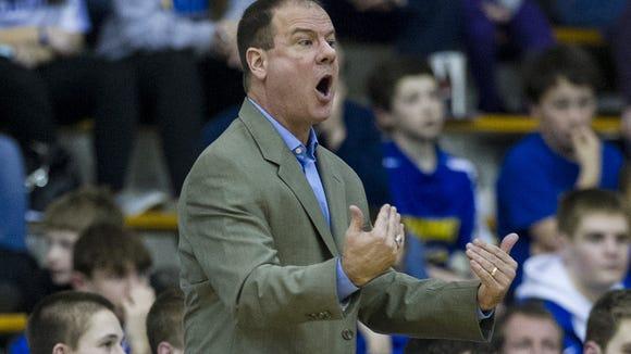 Carmel High School head coach, Scott Heady, instructs the team on the court during the first half of varsity basketball action Friday, Feb. 28, 2014, at Carmel High School.