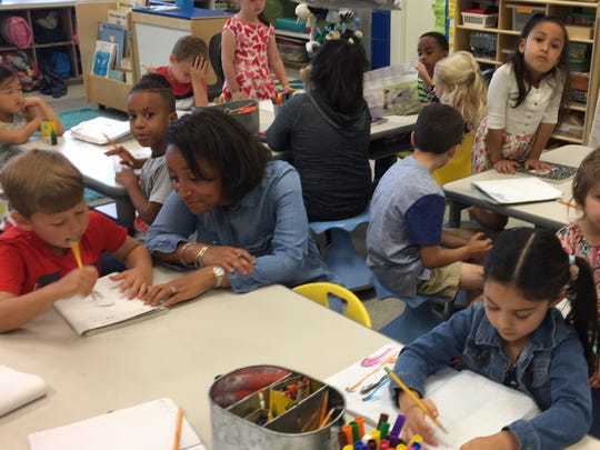 Terry Collins kindergarten class at Pike Road School write complete sentences on Wednesday.